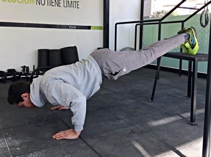 Añade dificultad a las flexiones